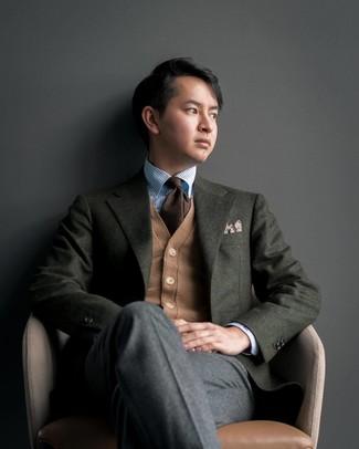 How to wear: charcoal wool dress pants, light blue vertical striped dress shirt, tan cardigan, dark green wool blazer