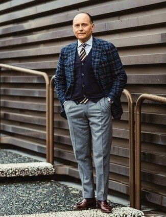 How to Wear a Navy Cardigan For Men: Putting together a navy cardigan and grey wool dress pants is a guaranteed way to inject elegance into your wardrobe. A pair of burgundy leather tassel loafers integrates smoothly within a myriad of combinations.