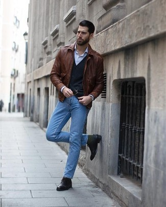 How to wear: light blue jeans, light blue vertical striped dress shirt, black cardigan, brown leather bomber jacket