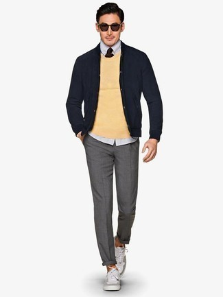 How to Wear Grey Canvas Low Top Sneakers For Men: Combining a yellow crew-neck sweater with grey chinos is a smart choice for a casually dapper ensemble. Introduce a pair of grey canvas low top sneakers to the mix to keep the ensemble fresh.