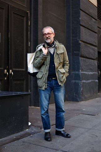 How to wear: blue jeans, grey dress shirt, black cardigan, olive military jacket