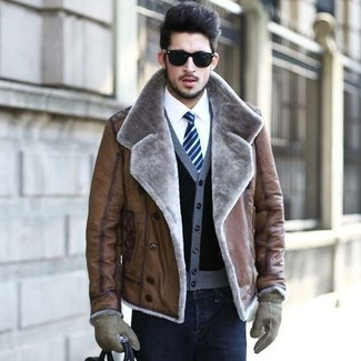 How to wear: black skinny jeans, white dress shirt, black cardigan, brown shearling jacket