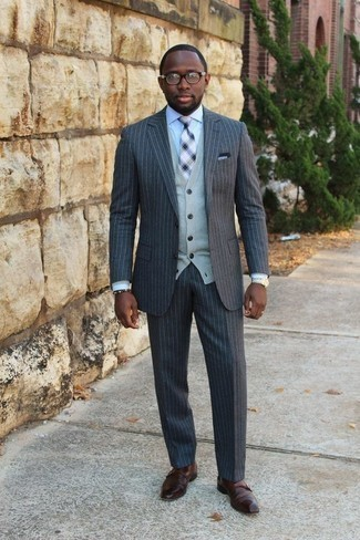 How to Wear a Grey Cardigan For Men: You're looking at the solid proof that a grey cardigan and a charcoal vertical striped suit look awesome if you pair them together in an elegant look for a modern guy. And if you wish to immediately up the ante of this getup with a pair of shoes, add a pair of brown leather double monks to the mix.