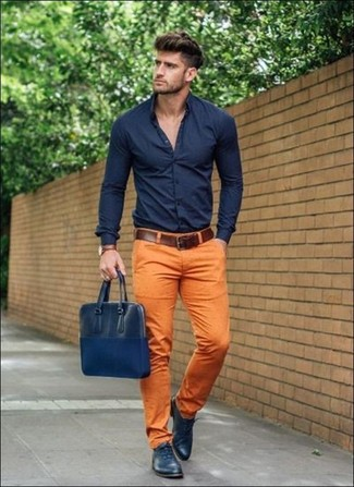 How to wear: navy dress shirt, orange chinos, navy leather oxford shoes, navy leather messenger bag