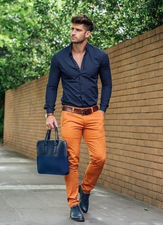 How to wear: navy dress shirt, orange chinos, navy leather oxford shoes, navy leather briefcase