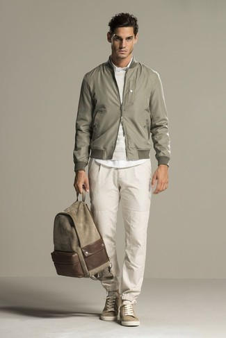 How to wear: beige sweatpants, white dress shirt, beige crew-neck sweater, olive bomber jacket