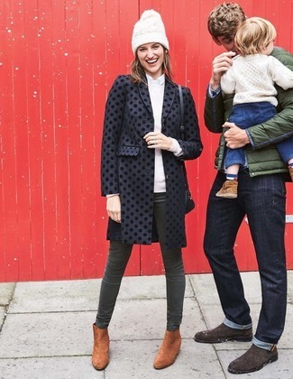 How to Wear Dark Green Skinny Jeans: Dial it down a notch in this practical combination of a black polka dot coat and dark green skinny jeans. To bring out a sophisticated side of you, add tobacco suede ankle boots to the mix.