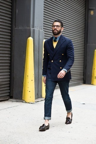 How to Wear a Yellow Crew-neck Sweater For Men: A yellow crew-neck sweater and navy jeans make for the perfect foundation for a casually stylish ensemble. For something more on the classier end to finish this outfit, introduce a pair of dark brown leather tassel loafers to the mix.