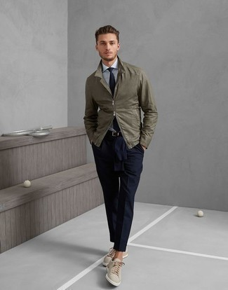 How to Wear a Light Blue Dress Shirt For Men: Try pairing a light blue dress shirt with navy dress pants and you'll ooze class and refinement. In the footwear department, go for something on the casual end of the spectrum and complete this ensemble with beige canvas low top sneakers.