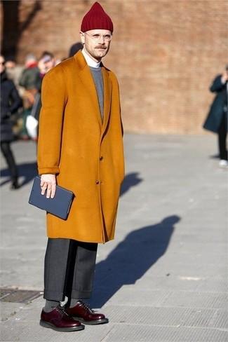 How to wear: black dress pants, white dress shirt, grey crew-neck sweater, mustard overcoat