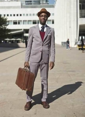 How to Wear a Brown Wool Hat For Men: Dress in a grey suit and a brown wool hat to achieve a seriously sharp and current relaxed casual outfit.