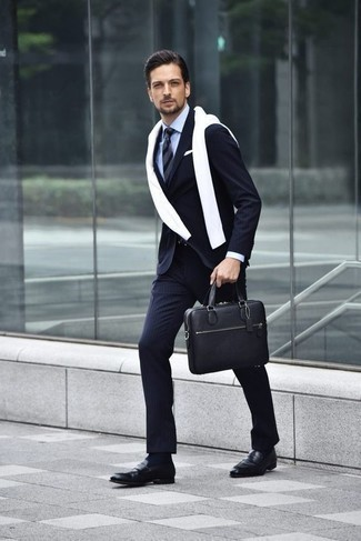 How to Wear a Navy Horizontal Striped Tie For Men: This pairing of a navy vertical striped suit and a navy horizontal striped tie resonates sophistication and versatility. Black leather loafers are the most effective way to inject a sense of stylish casualness into this look.