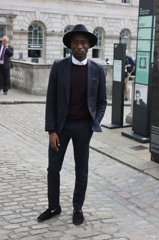 How to Wear Black Suede Tassel Loafers: This combination of a navy suit and a dark purple crew-neck sweater oozes elegance and sophistication. All you need now is a great pair of black suede tassel loafers to round off your look.