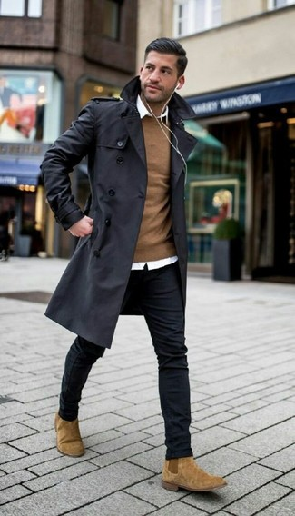 How to wear: black skinny jeans, white dress shirt, brown crew-neck sweater, black trenchcoat
