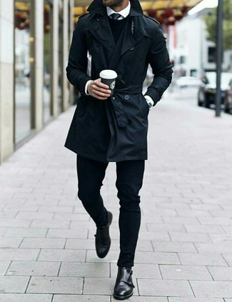 How to Wear a Black Tie For Men: We're loving how this combination of a black trenchcoat and a black tie instantly makes men look elegant and stylish. In the shoe department, go for something on the casual end of the spectrum with a pair of black leather double monks.