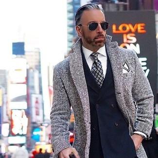 How to wear: grey plaid tie, white dress shirt, navy double breasted blazer, grey herringbone overcoat