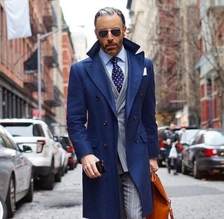 How to wear: grey vertical striped dress pants, light blue dress shirt, grey vertical striped double breasted blazer, navy overcoat