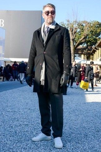 Men's Looks & Outfits: What To Wear In Winter: For an outfit that's elegant and gasp-worthy, rock a black overcoat with charcoal wool dress pants. Take an otherwise sober ensemble down a more laid-back path by rocking white leather low top sneakers. You know this combo is great to stay snug and look great throughout the winter.