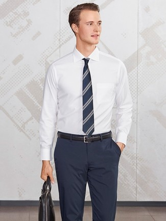 How to wear: white dress shirt, navy dress pants, black leather briefcase, navy vertical striped tie