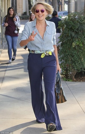 How to wear: light blue chambray dress shirt, navy flare pants, navy leather tote bag, yellow print silk scarf