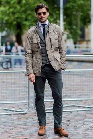 How to wear: charcoal chinos, white dress shirt, olive quilted gilet, beige military jacket