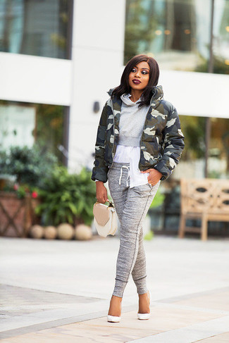 How to Wear a Tan Leather Handbag: If you appreciate comfort above all else, try pairing an olive camouflage puffer jacket with a tan leather handbag. White leather pumps will infuse an added dose of refinement into an otherwise standard getup.