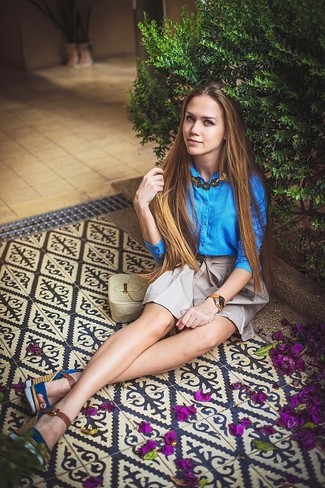 Pair a blue button-front shirt with jewelry for a stylish and sophisticated look. A pair of blue suede wedge sandals brings the dressed-down touch to the look. As you can see, this is a killer pick for warm weather.