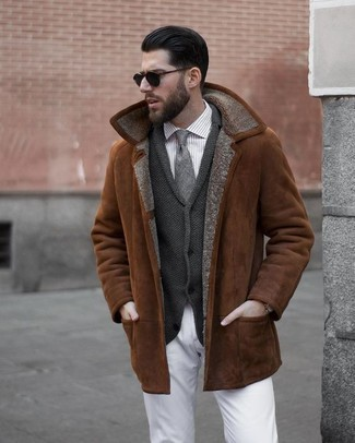 How to wear: white chinos, grey vertical striped dress shirt, charcoal shawl cardigan, tobacco shearling jacket