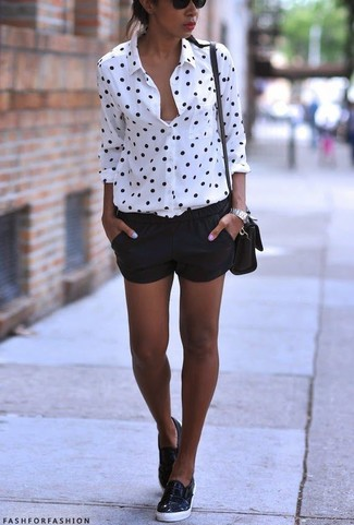 Go for a white and black polka dot dress shirt and black shorts to effortlessly deal with whatever this day throws at you. Throw in a pair of black leather slip-on sneakers for a more relaxed aesthetic.