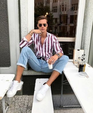 How to wear: white and red vertical striped dress shirt, light blue skinny jeans, white leather low top sneakers, black leather belt