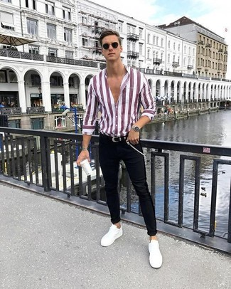 How to wear: white and red vertical striped dress shirt, black skinny jeans, white leather low top sneakers, black leather belt