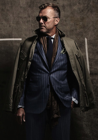 An olive field jacket looks so sophisticated when paired with a navy vertical striped suit.