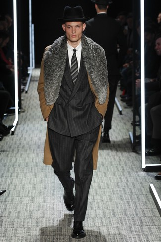 How to wear: black leather dress boots, white dress shirt, black vertical striped suit, brown fur collar coat