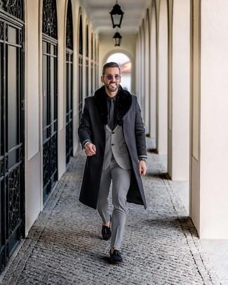 How to wear: black suede tassel loafers, black dress shirt, grey suit, black fur collar coat