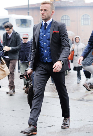 How to Wear a Charcoal Suit: This combination of a charcoal suit and a blue gilet couldn't possibly come across as anything other than seriously dapper and refined. Our favorite of a myriad of ways to complete this getup is with a pair of dark brown leather brogues.