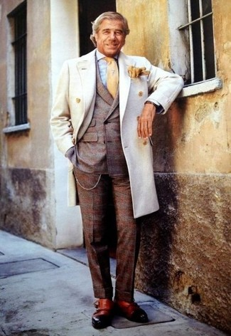 How to wear: tan leather double monks, light blue gingham dress shirt, brown plaid wool suit, white overcoat