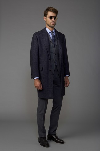 How to wear: black leather oxford shoes, light blue dress shirt, charcoal suit, charcoal overcoat