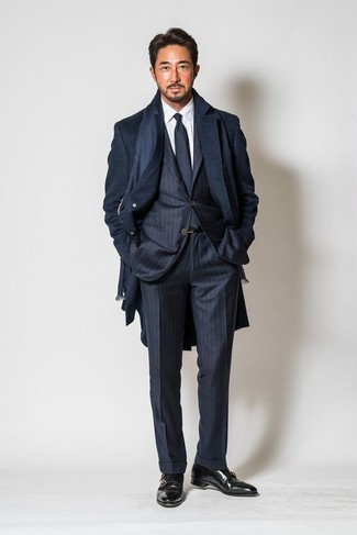 How to wear: black leather double monks, white dress shirt, navy vertical striped suit, navy overcoat