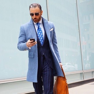 How to wear: tobacco leather tote bag, white dress shirt, navy vertical striped suit, light blue overcoat