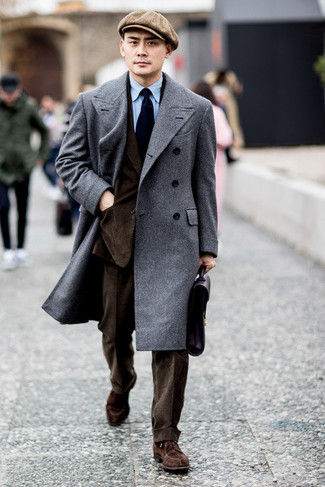 How to Wear a Dark Brown Suit In a Dressy Way: A dark brown suit looks so classy when married with a grey overcoat in a modern man's combination. A trendy pair of brown suede derby shoes is an effective way to add a hint of stylish effortlessness to your getup.
