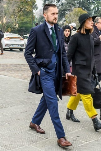 How to Wear a Brown Leather Zip Pouch For Men: For an off-duty look, marry a navy overcoat with a brown leather zip pouch — these two pieces work nicely together. Not sure how to complement this outfit? Wear a pair of brown leather oxford shoes to polish it off.