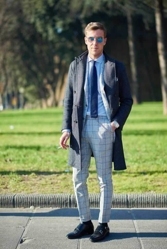 How to Wear a Navy Knit Tie For Men: Opt for a navy overcoat and a navy knit tie and you'll ooze elegance and polish. For a more laid-back finish, why not add black leather double monks to this ensemble?