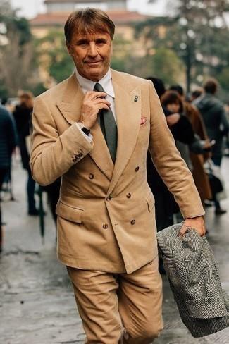 How to Wear a Grey Herringbone Overcoat: Go all out in a grey herringbone overcoat and a tan corduroy suit.