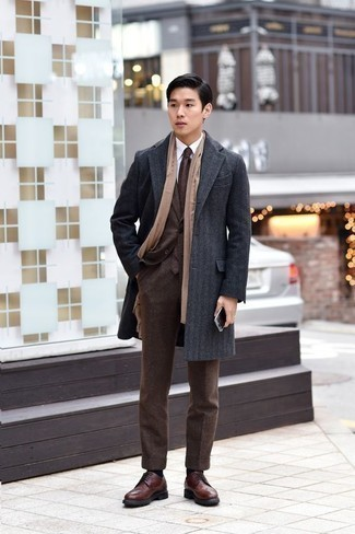 How To Wear a Suit With Brogues: This pairing of a suit and a charcoal overcoat is a fail-safe option when you need to look like a true connoisseur of men's style. And if you need to easily play down this look with a pair of shoes, introduce brogues to your outfit.