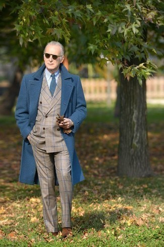 Fashion for Men Over 60: What To Wear: A blue overcoat and a beige plaid suit are absolute mainstays if you're putting together a dapper closet that matches up to the highest menswear standards. Introduce brown suede derby shoes to the mix et voila, the ensemble is complete. This getup proves that as a 60-something gent, you still have a wide array of style options.