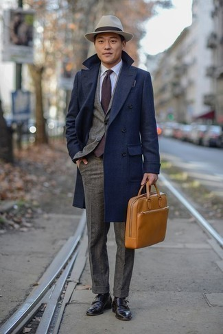 How to Wear Dark Brown Leather Double Monks: Irrefutable proof that a navy overcoat and a grey wool suit look amazing when paired together in a refined ensemble for a modern dandy. Want to play it down on the shoe front? Round off with a pair of dark brown leather double monks for the day.