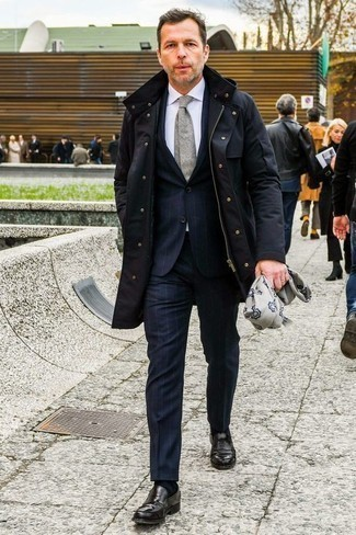 How to Wear a Navy Parka For Men: This combination of a navy parka and a navy vertical striped suit is hard proof that a straightforward ensemble can still be really interesting. Complete this ensemble with a pair of black leather loafers to instantly spice up the ensemble. So if you need style inspiration for dressing in your forties, this pairing is a perfect example.