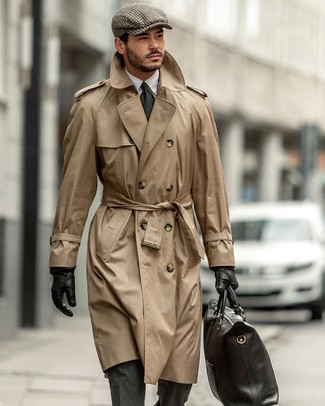 How to Wear a Black Leather Tote Bag For Men: A tan trenchcoat and a black leather tote bag are a great outfit formula to add to your closet.
