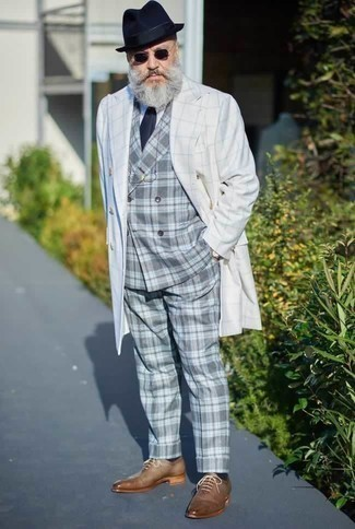 How to Wear a Grey Plaid Suit: A grey plaid suit and a white trenchcoat are an extra smart outfit for you to try. Tan leather oxford shoes integrate perfectly within plenty of outfits.