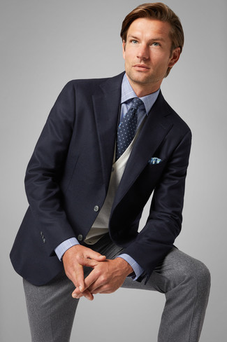 How to wear: grey wool dress pants, light blue plaid dress shirt, beige sweater vest, navy blazer